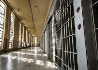 Image of jail cells via Shutterstock
