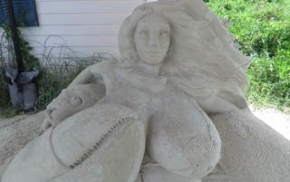 Image of sand mermaid via Cape Cod Times