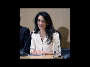 Amal Clooney via Shutterstock/Kostas Koutsaftikis