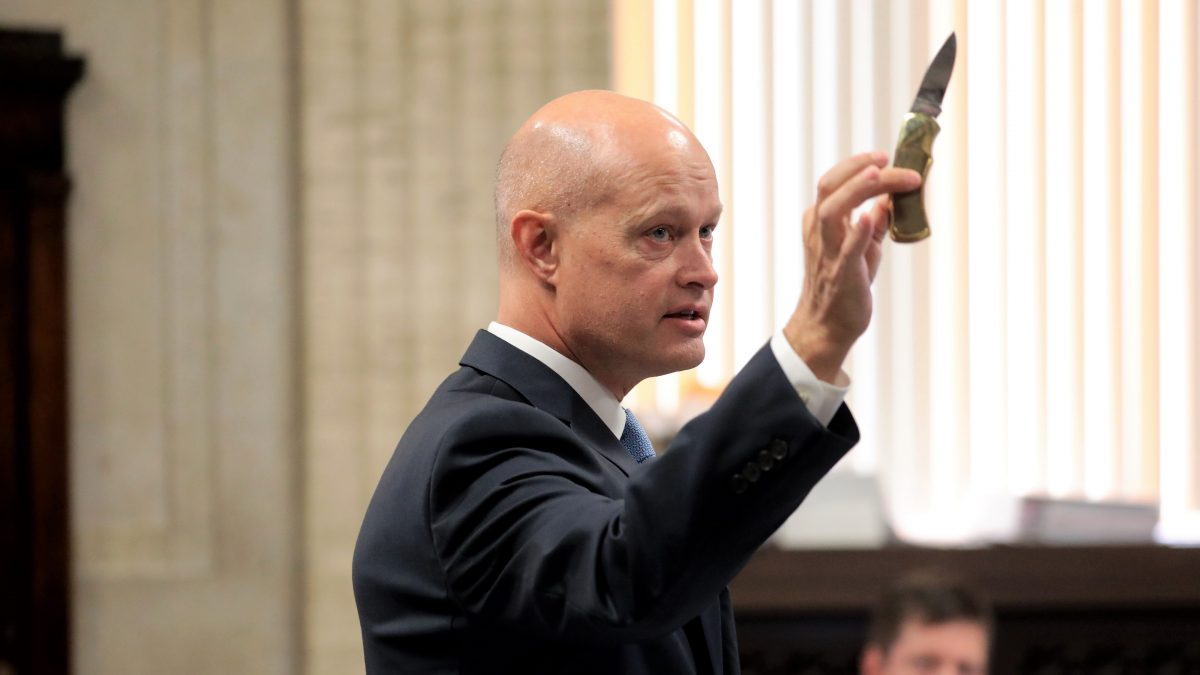 Special prosecutor Joseph McMahon holds the 3-inch blade Laquan McDonald carried the night he was killed, during opening statements in the trial for Chicago police Officer Jason Van Dyke at the Leighton Criminal Court Building on September 17, 2018, in Chicago. - Van Dyke faces murder charges for shooting 17-year-old Laquan McDonald 16 times in an October 2014 confrontation. The incident, captured on police dash-cam video, has upended the city's politics with fears of violence if the officer is acquitted.