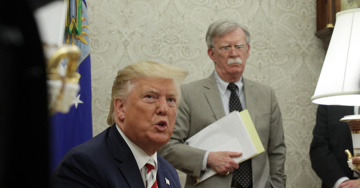 WASHINGTON, DC - AUGUST 20: U.S. President Donald Trump speaks to members of the media as National Security Adviser John Bolton listens during a meeting with President of Romania Klaus Iohannis in the Oval Office of the White House August 20, 2019 in Washington, DC. This is Iohannis' second visit to the Trump White House and the two leaders are expected to discuss bilateral issues during their meeting.