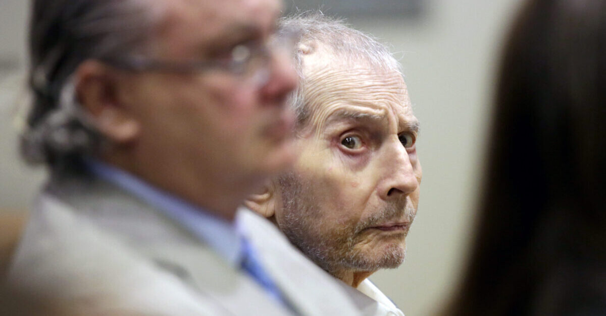 "LOS ANGELES, CA - MARCH 10: Real estate heir Robert Durst, center, sits with his co-defense attorney David Chesnoff during his murder trial on March 10, 2020 in Los Angeles, California. Millionaire Robert Durst is accused of murdering his friend and long-time confidante Susan Berman in 2000. Prosecutors have built their case around evidence from the HBO documentary ""The Jinx."" which helped lead to Durst's arrest."