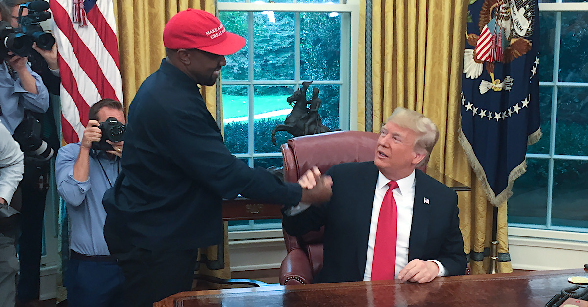"(Files) in this file photo US President Donald Trump meets with rapper Kanye West in the Oval Office of the White House in Washington, DC, October 11, 2018. - Kanye West, the entertainment mogul who urges listeners in one song to ""reach for the stars, so if you fall, you land on a cloud,"" announced July 4, 2020, he is challenging Donald Trump for the US presidency in 2020."