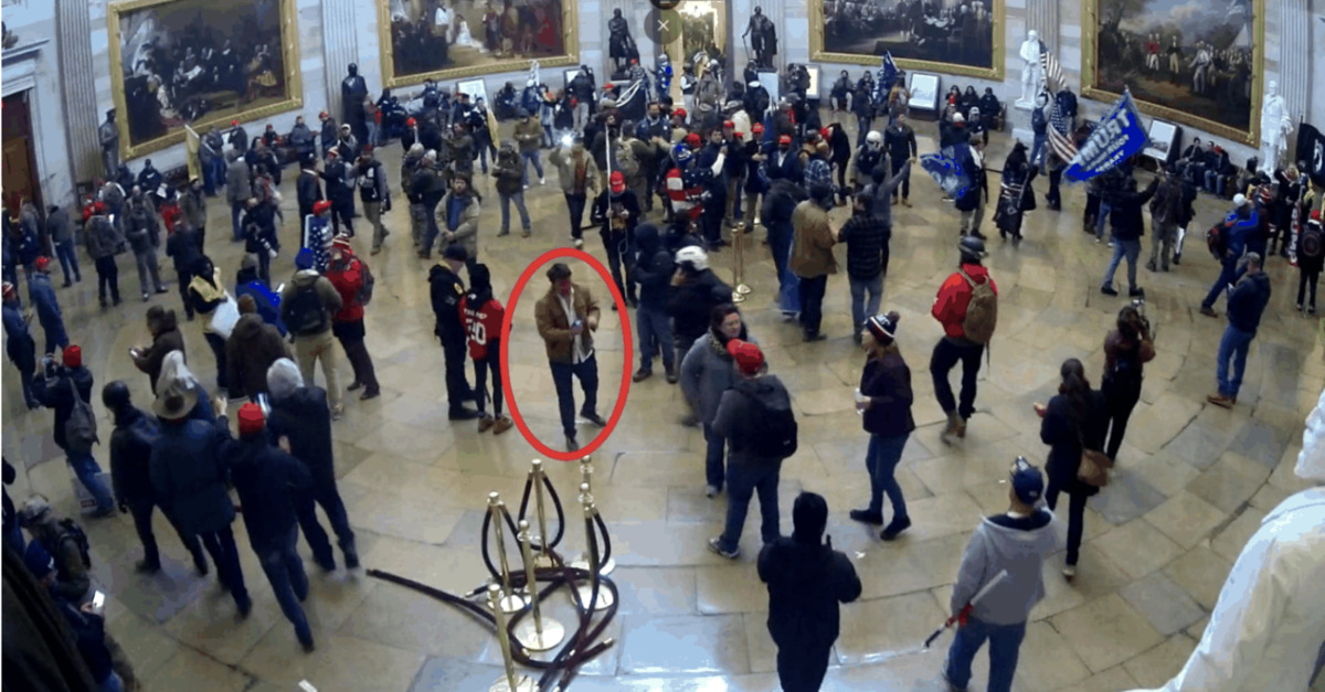 Adam Weibling allegedly stands in the Capitol Rotunda
