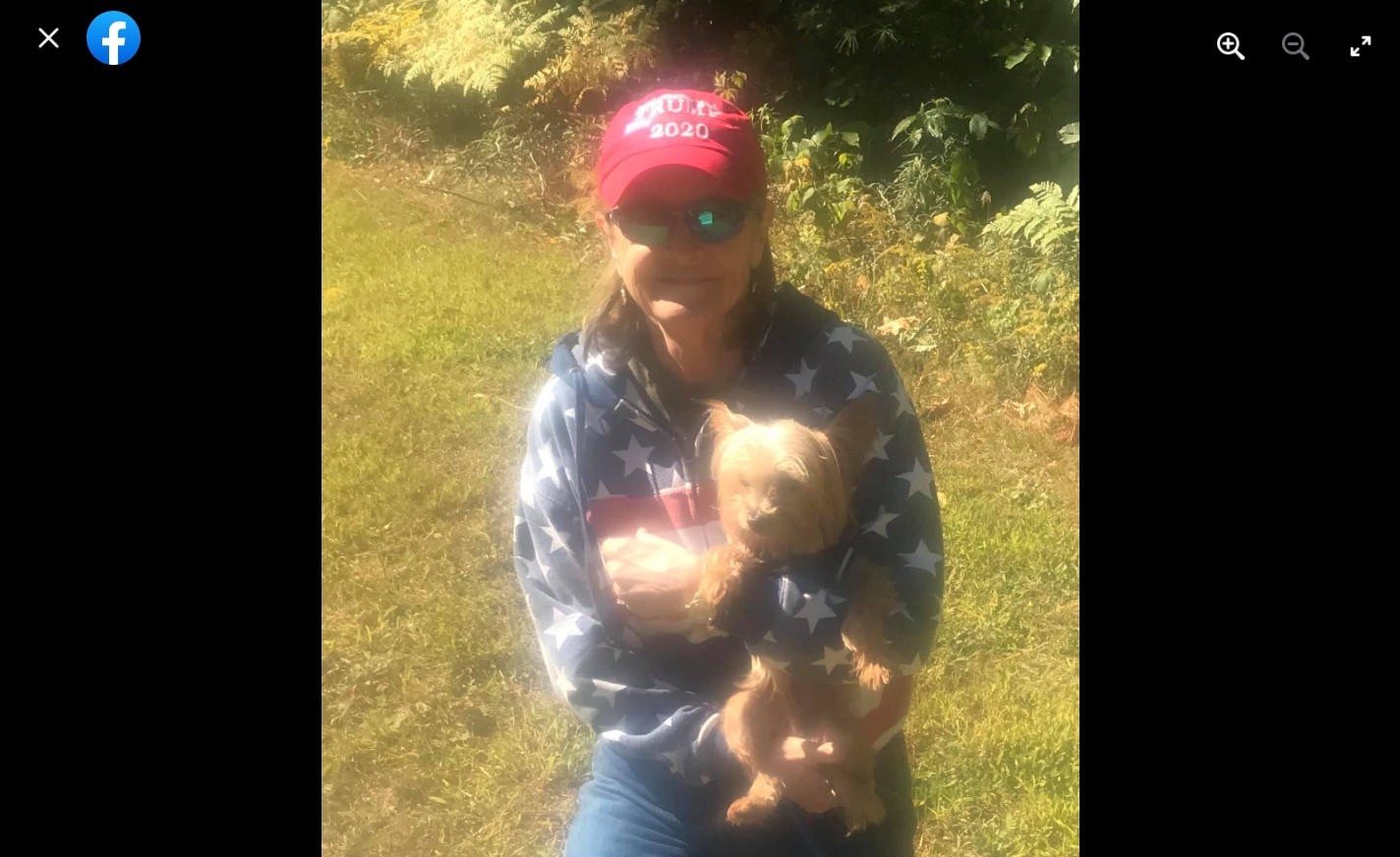 Screengrab from what seems to be the suspect's Facebook account. She is holding a small dog.