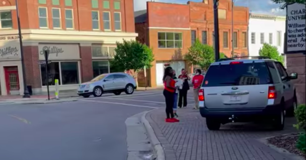 The SUV, alleged to have been driven by Judge John Tyson, after nearly hitting protesters and running onto the sidewalk.