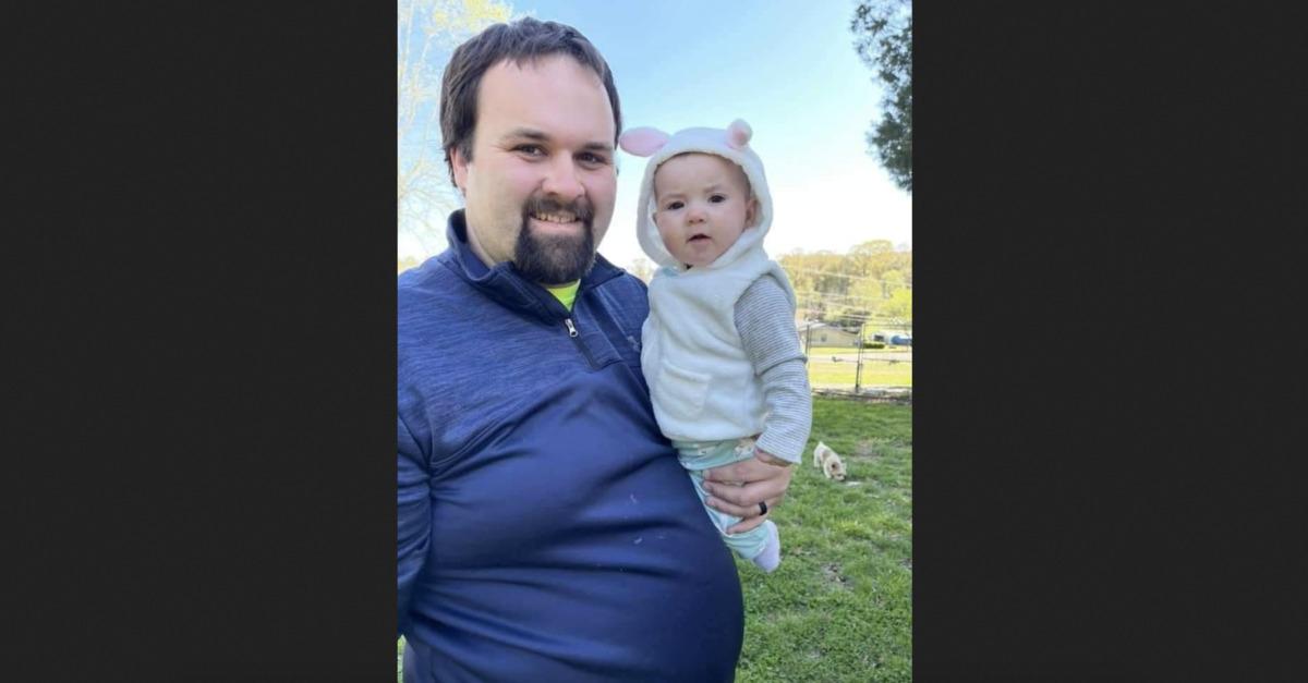 Cody Fox holds his baby daughter Ariana