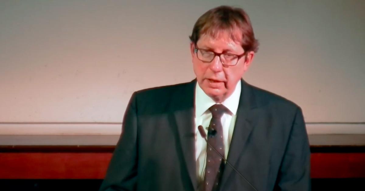 Dr. Dirk Obbink speaking at lecturn