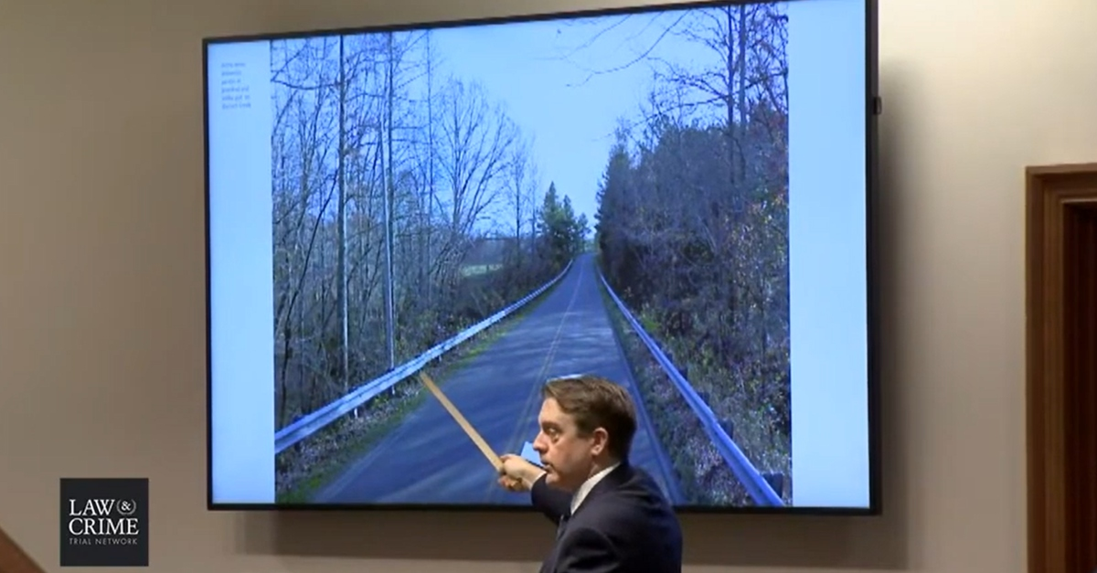 Prosecutor Ray Crouch pointing out where Joseph Ray Daniels allegedly stood at Garners Creek Road bridge