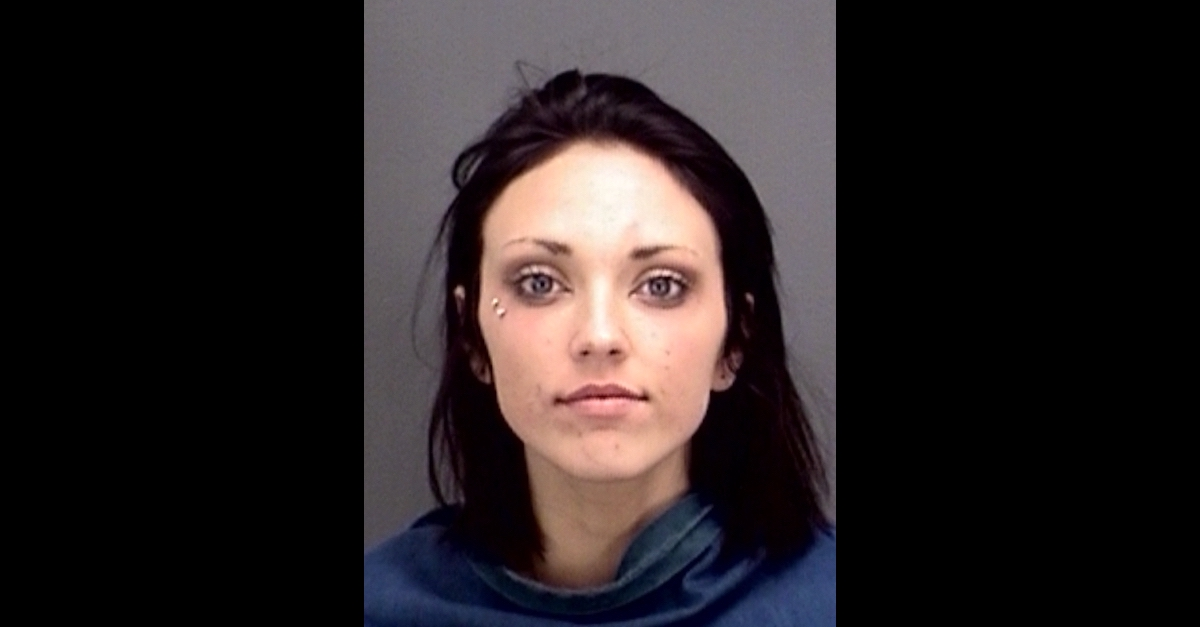 Riley Weiss appears in a mugshot.
