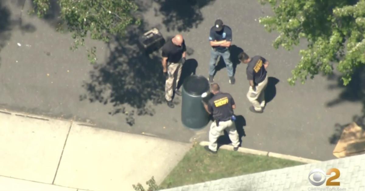 Authorities surround the barrel containing Nicole Flanagan's body