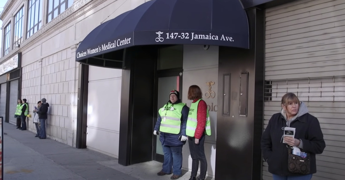 Volunteers and protesters are seen gathering outside Choices Women's Medical Center in Jamaica, Queens.