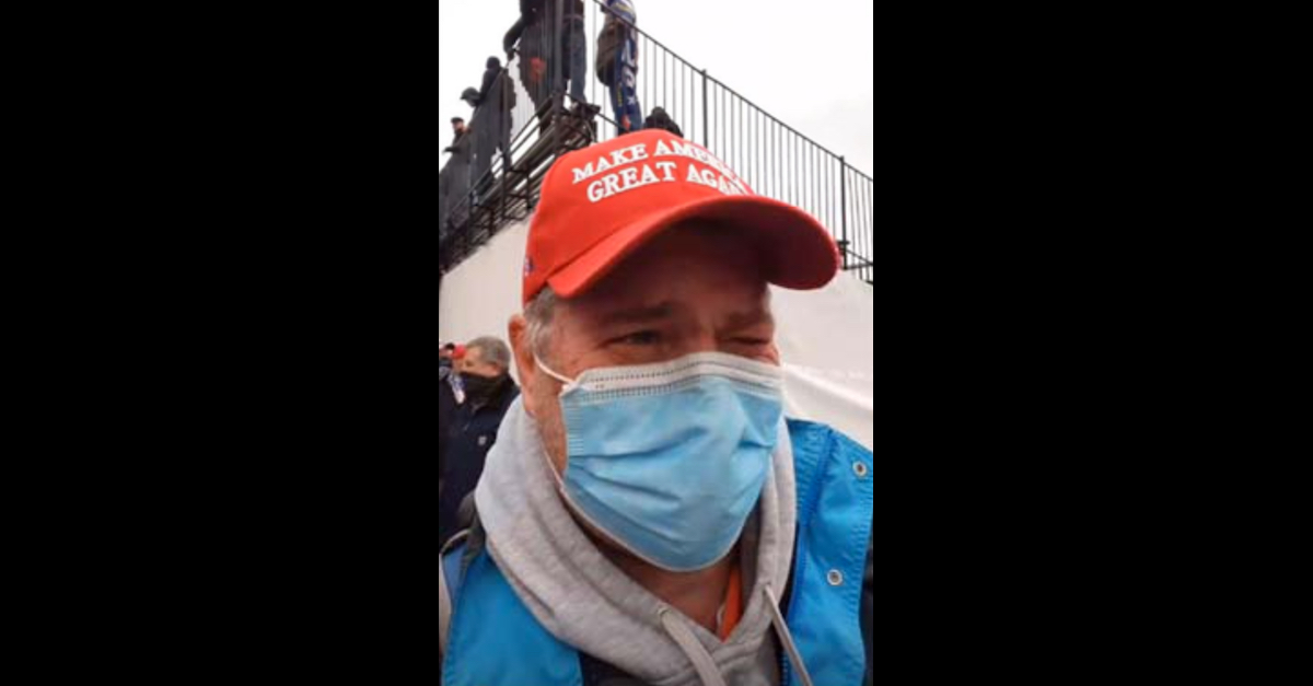 """Robert Maurice Reeder appears in a January 6, 2021 photo wearing a """"Make America Great Again"""" hat commonly associated with the Donald Trump campaign."""