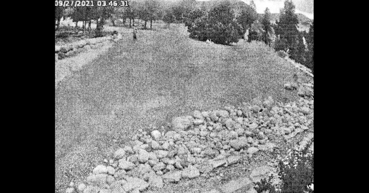 A security camera image embedded within a Chaffee County, Colo. arrest affidavit allegedly shows Shoshona Darke in the distance approaching a home formerly owned by Barry Morphew.