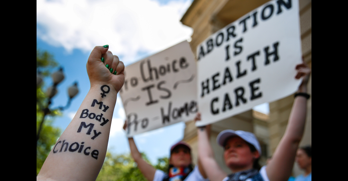 Women from hold signs during a protest against recently passed abortion bans at the Georgia State Capitol building on May 21, 2019 in Atlanta.