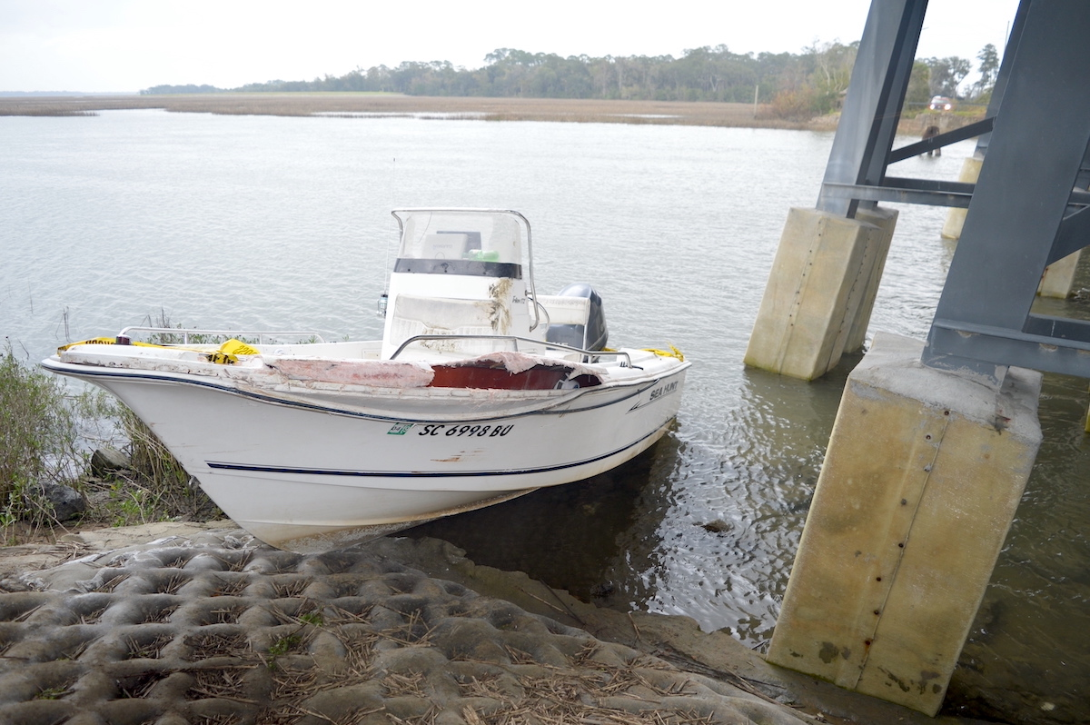 This image taken by a South Carolina coroner shows a boat owned by Alex Murdaugh and allegedly operated by Paul Murdaugh after it crashed into a bridge pier on Feb. 23, 2019. (Image obtained from the South Carolina Attorney General's Office pursuant to a Freedom of Information Act request by Law&Crime.)