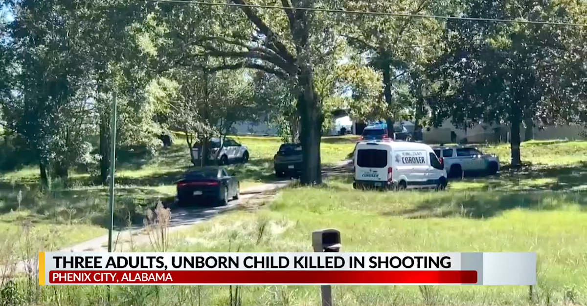 A television screengrab shows the scene in Phenix City, Alabama, where four people, including an unborn child, died in a murder-suicide.