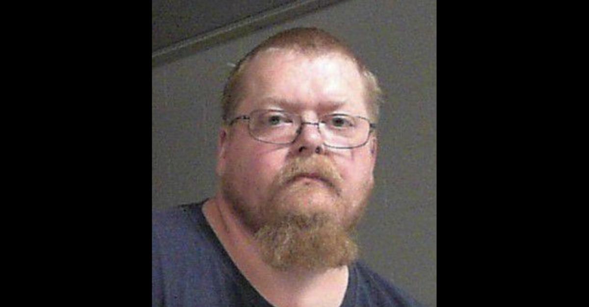 Carl Rose Jr. appears in a mugshot