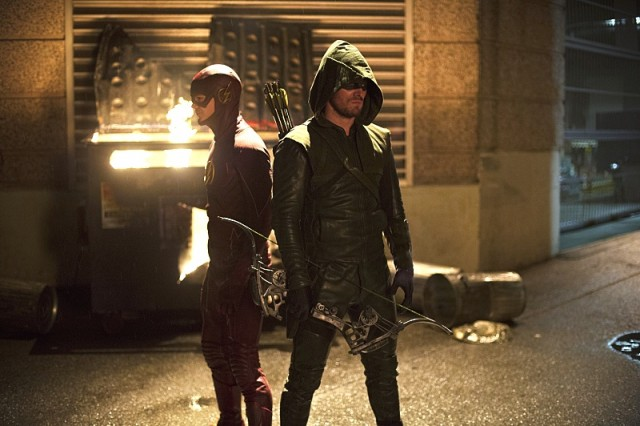 """The Flash -- """"Flash vs. Arrow"""" -- Image FLA108c_0157b -- Pictured (L-R): Grant Gustin as The Flash and Stephen Amell as The Arrow -- Photo: Diyah Pera /The CW -- © 2014 The CW Network, LLC. All rights reserved."""