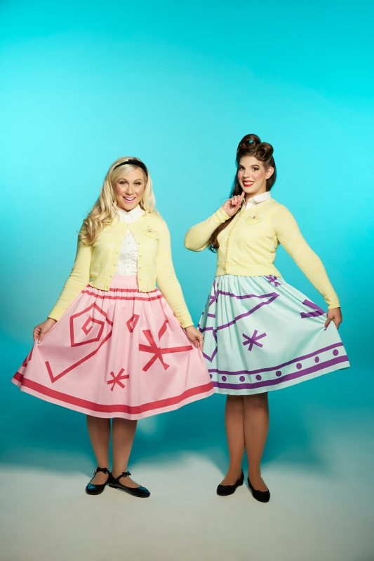 image: Her Universe Ashley Eckstein and model in Disney Teacup skirts