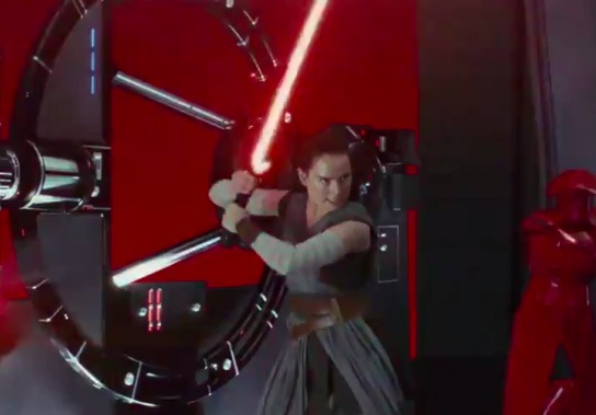 Rey with Kylo's lightsaber in Star Wars: The Last Jedi