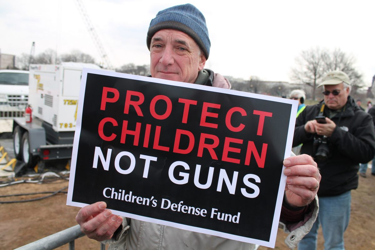 protect children not guns protest sign