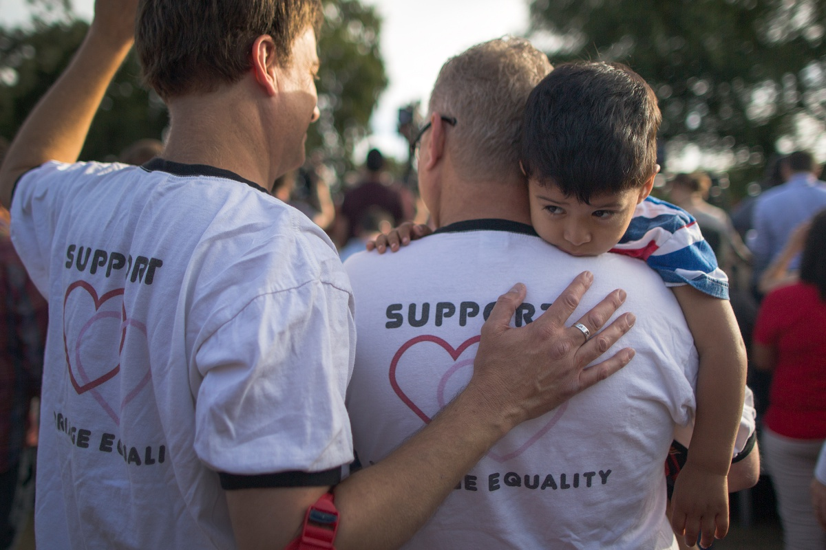 WEST HOLLYWOOD, CA - JUNE 26: Mark Beckfold and Steve Ledoux (R) , who are married, hold their foster son at a celebration of the Supreme Court ruling on same-sex marriage on June 26, 2015 in West Hollywood, California. The Supreme Court ruled today that same-sex couples have a constitutional right to marry nationwide without regard to their state's laws. (Photo by David McNew/Getty Images)