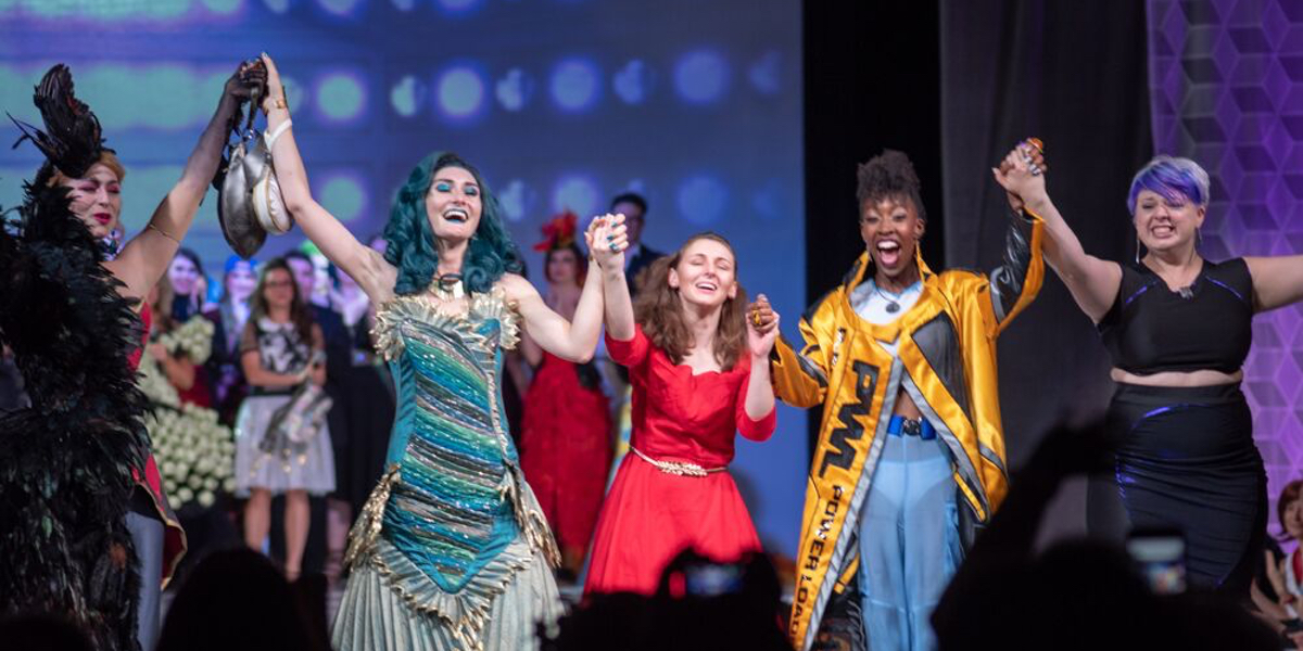 The winners of the Her Universe Fashion Show celebrate their victory in a moment captured by Brian Sims