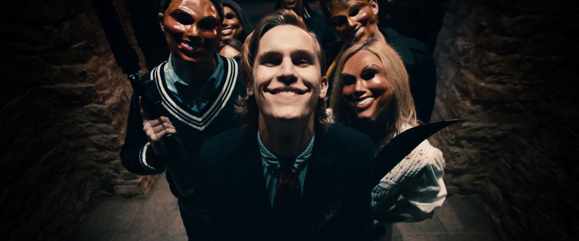 A group of Purgers stalk a family in 2013's The Purge