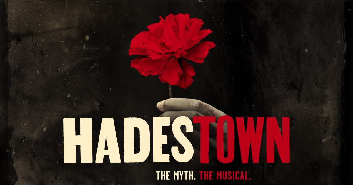 Hadestown musical title art of a hand holding a flower.