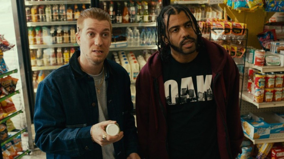 Rafael Calas and Daveed Diggs looking confused and taken aback in Blindspotting.