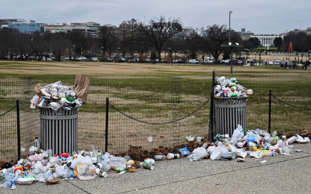 """The White House is seen in the background, as trash lays uncollected on the National Mall due to the partial shutdown of the US government on January 2, 2019 in Washington, DC. - President Donald Trump warned Wednesday the US federal government may not fully reopen any time soon, as he stood firm on his demand for billions of dollars in funding for a border wall with Mexico. Addressing a cabinet meeting on the 12th day of the partial shutdown, Trump warned it """"could be a long time"""" before the impasse is resolved. (Photo by Andrew Caballero-Reynolds / AFP) (Photo credit should read ANDREW CABALLERO-REYNOLDS/AFP/Getty Images)"""