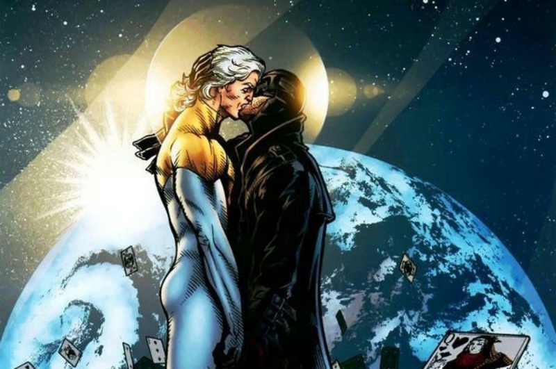 Midnighter and Apollo kissing each other with the earth in the background