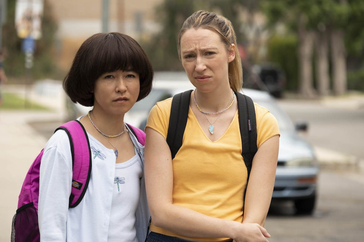 PEN15's Maya and Anna stare into the camera with pre-teen distain