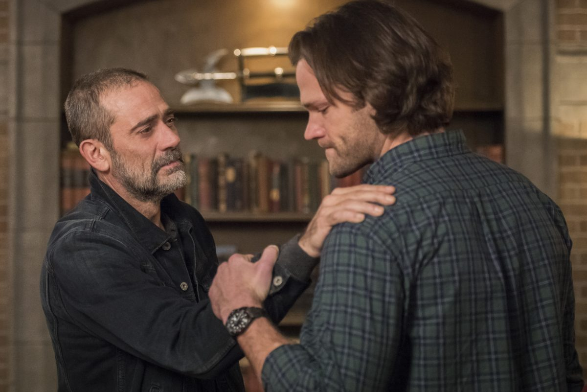 John Winchester places a hand on Sam Winchester's shoulder in Supernatural.
