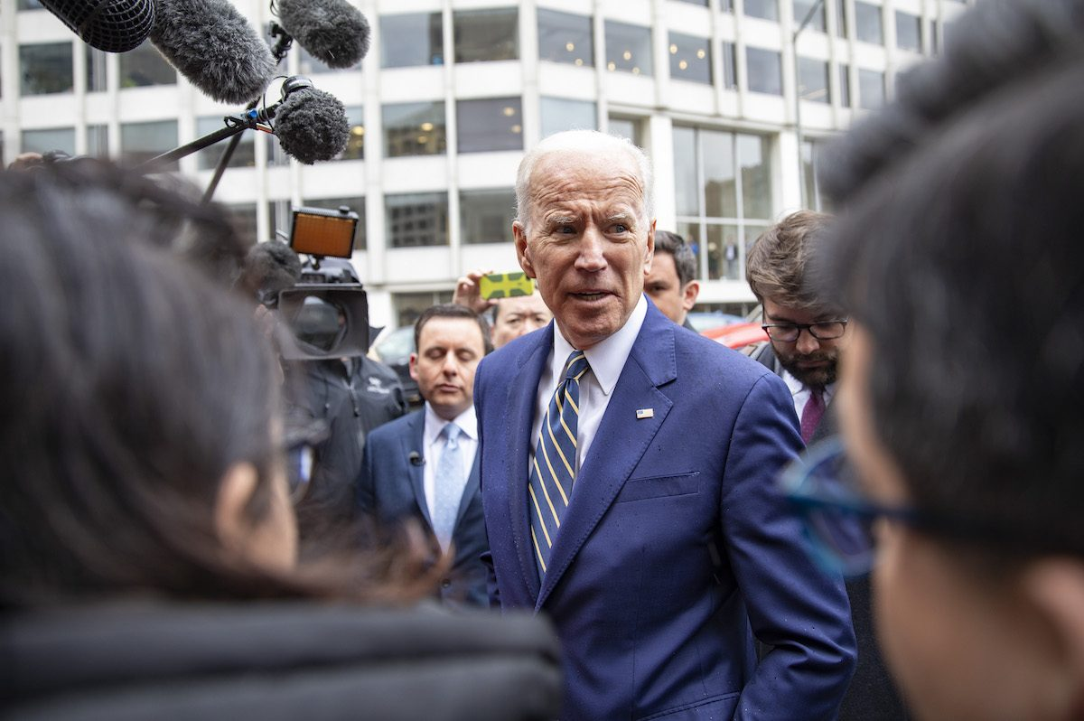 Joe Biden talking to reporters, telling them he's not sorry for anything.