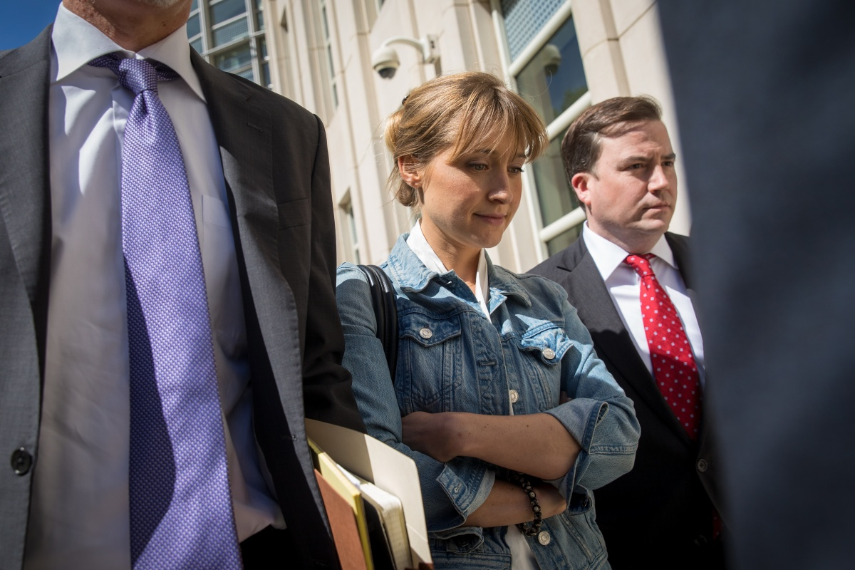 Actress Allison Mack exits the U.S. District Court for the Eastern District of New York following a status conference, June 12, 2018 in the Brooklyn borough of New York City. Mack was charged in April with sex trafficking for her involvement with a self-help organization for women that forced members into sexual acts with their leader. The group, called Nxivm, was led by founder Keith Raniere, who was arrested in March on sex-trafficking charges. (Photo by Drew Angerer/Getty Images)