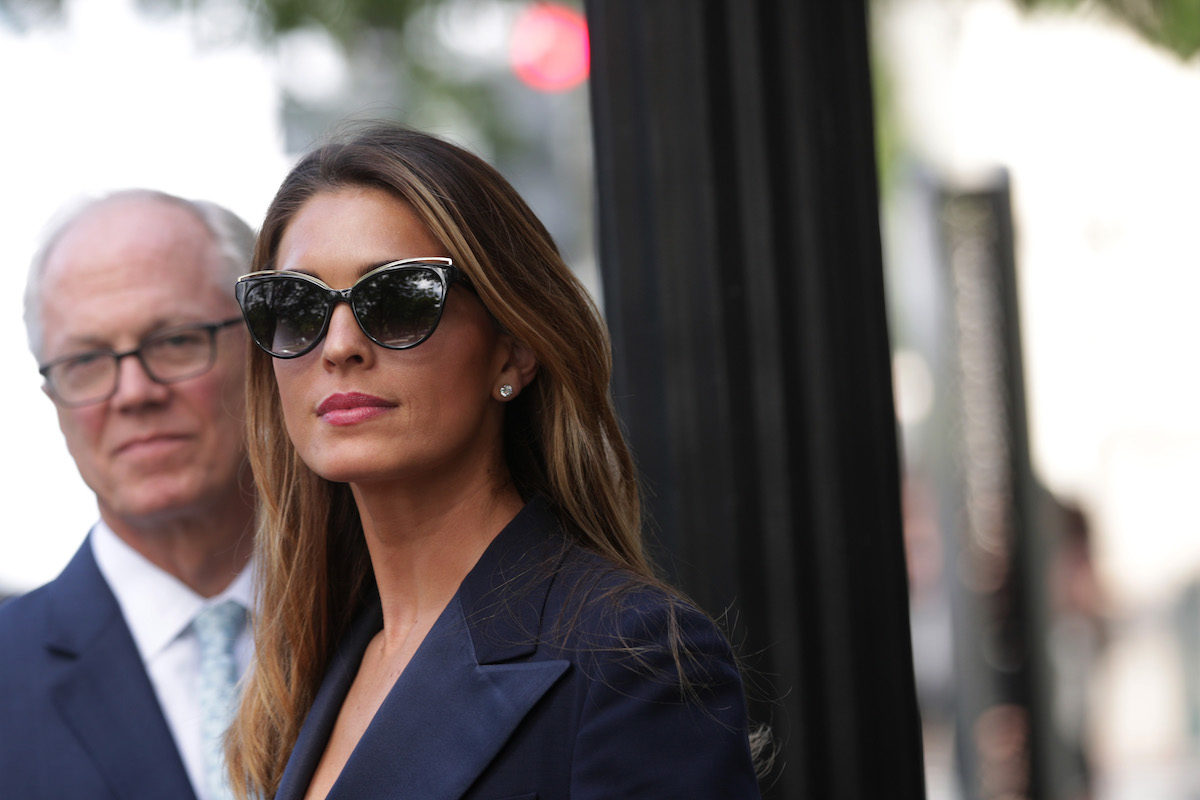 Hope Hicks smiles in sunglasses following her closed-door interview with Congress.