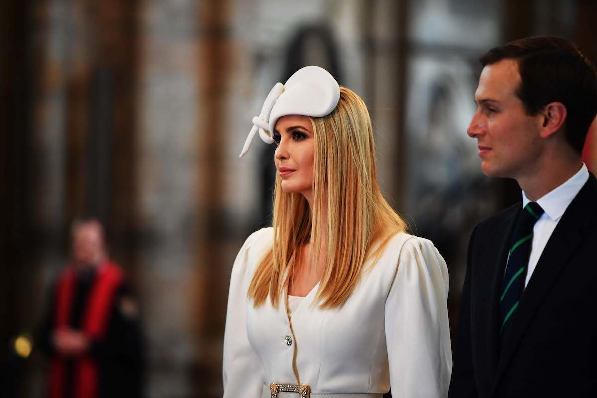 Ivanka Trump wears a stupid hat next to Jared Kushner at Westminster Abbey.