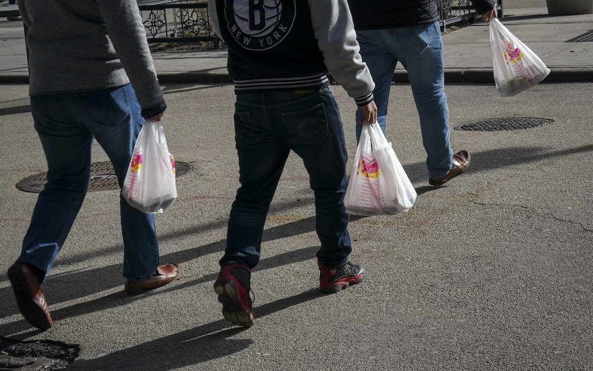 People carry plastic bags