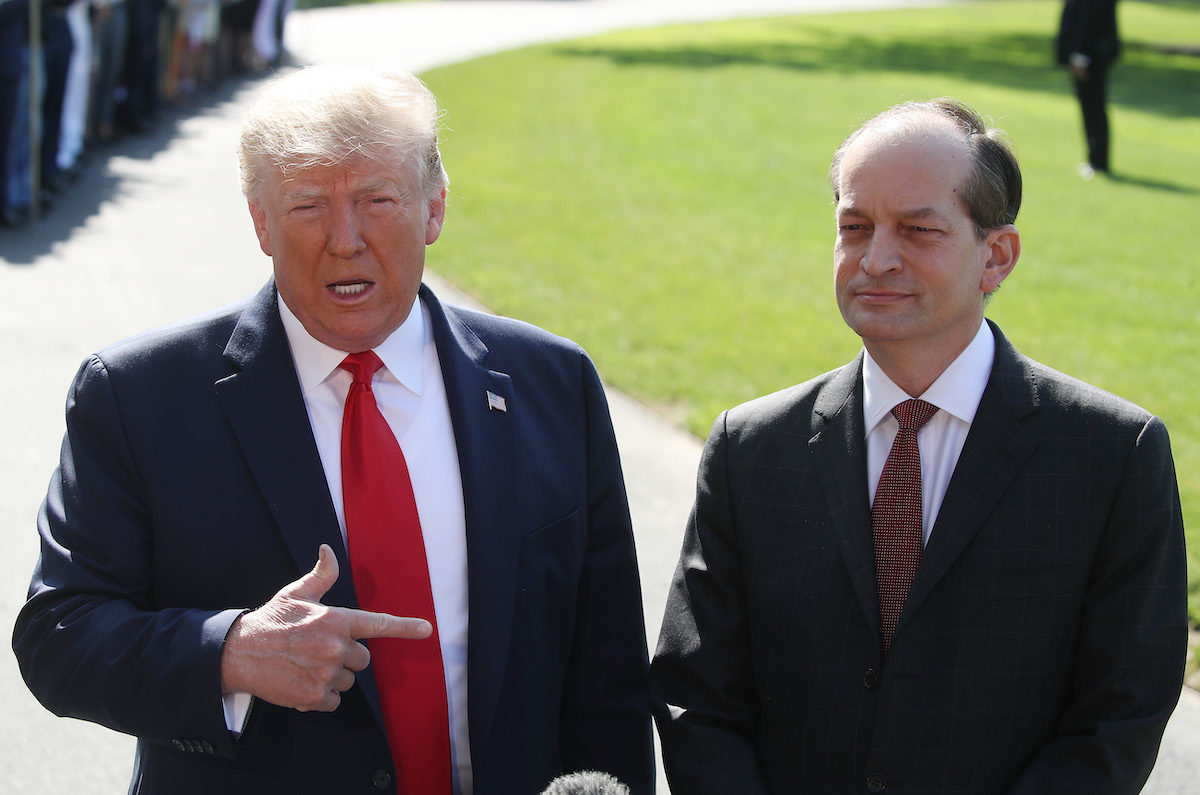 Trump defends Alex Acosta in front of reporters outside the White House.