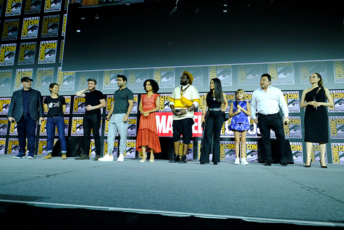 the cast of the eternals and kevin feige at comic con