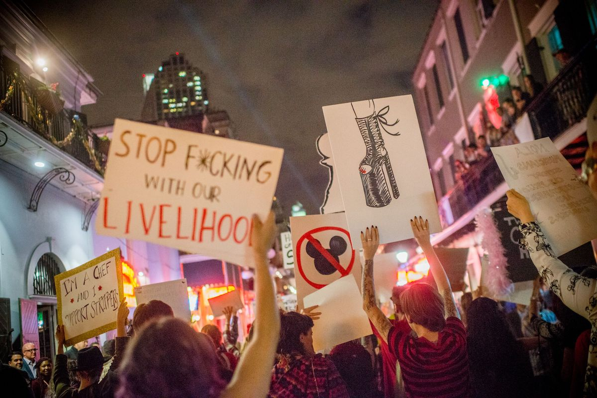 Strip club dancers, workers, and supporters march in in New Orleans.