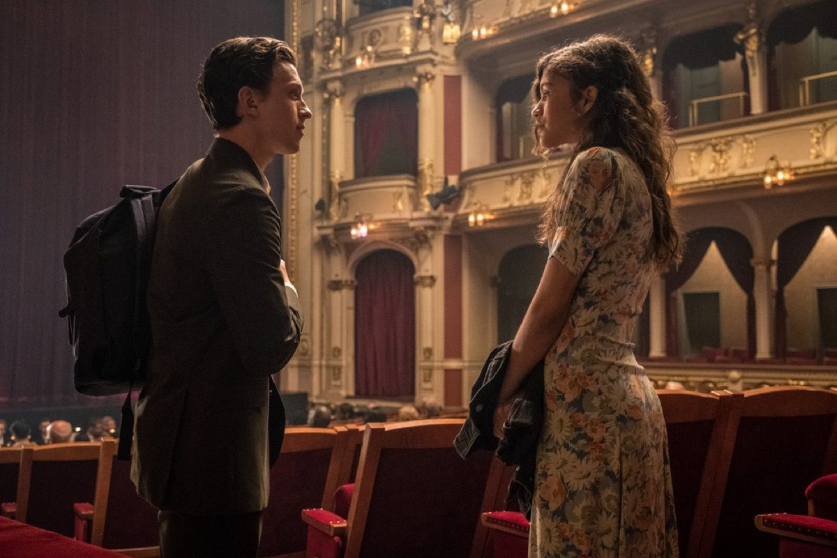 Peter Parker (Tom Holland) talks to MJ (Zendya) in a theater Spider-Man: Far From Home.