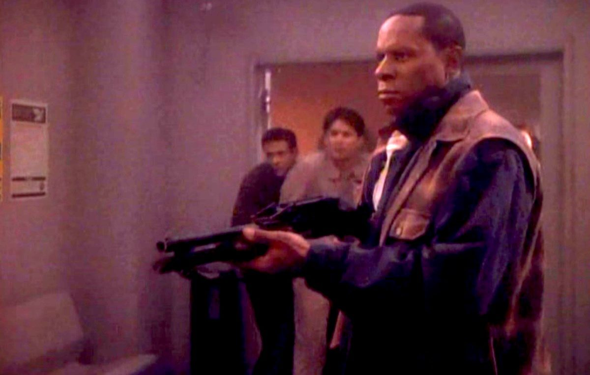 "Avery Brooks as Benjamin Sisko, brandishing a shotgun in Star Trek: Deep Space Nine's ""Past Tense""(1993)."