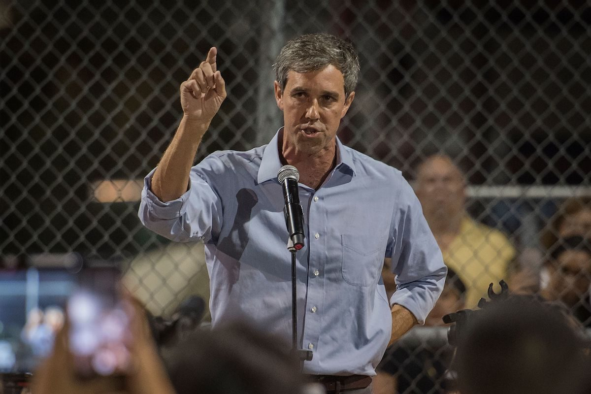 Beto O'Rourke speaks to the crowd during a prayer and candle vigil.