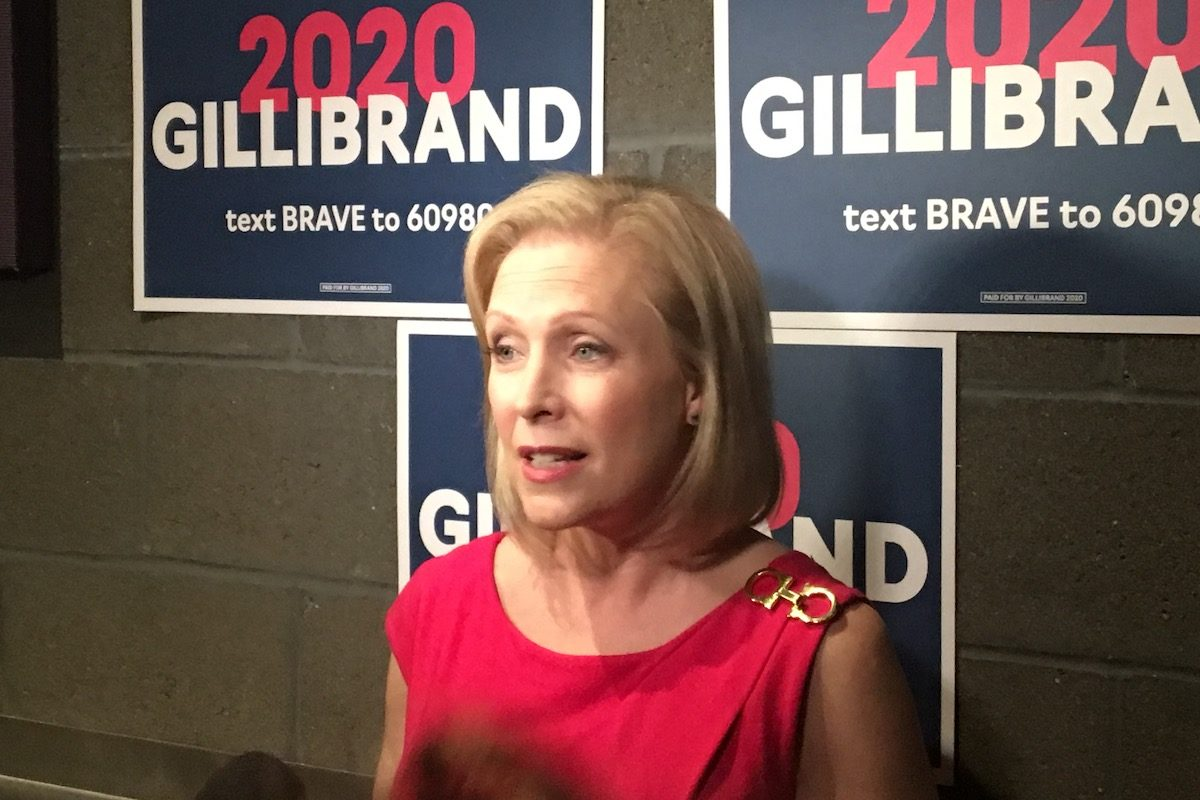 Kirsten Gillibrand speaks to reporters following a town hall in St. Louis, MO.