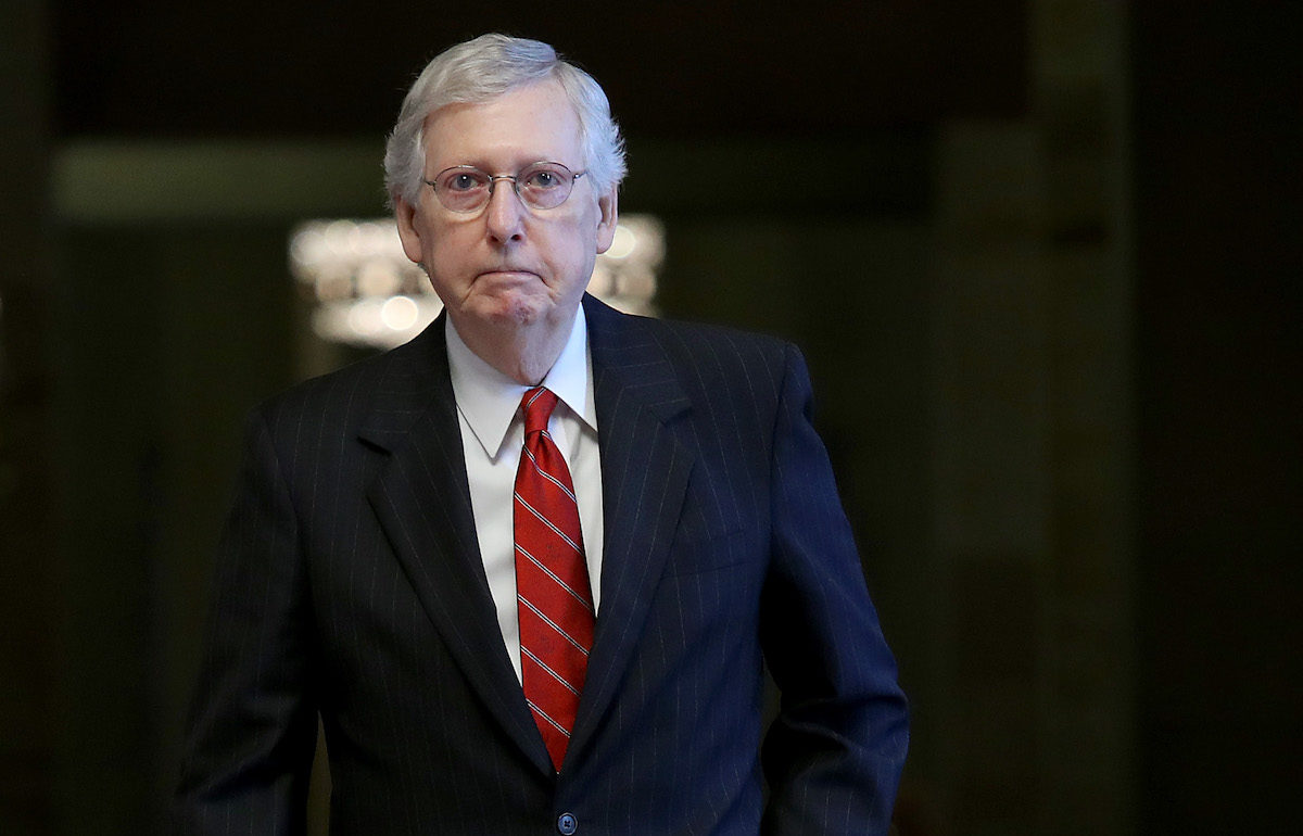 Mitch McConnell, the absolute worst, walks through the Capitol Building.