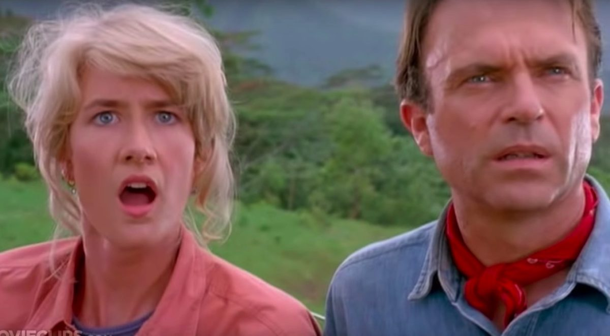 Sattler and Grant looking surprised as they stare at dinosaurs for the first time in Jurassic Park.