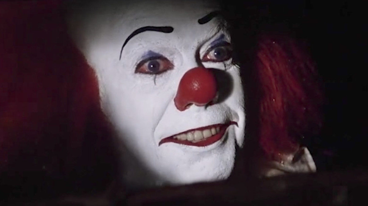 Tim Curry as Pennywise the Clown in IT
